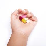 Baby hand holding drugs Stock Photo