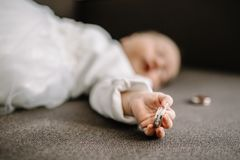 Baby Hand Holding Gold Wedding Ring stock photography