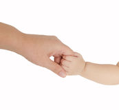 Baby hand holding her mother finger. Isolated on white background Royalty Free Stock Image