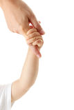 Baby hand holding mother finger. Isolated Stock Photo