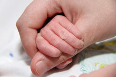 Baby hand holding motherfinger, new born baby. Photo of the Baby hand holding motherfinger, new born baby royalty free stock images