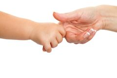 Baby hand holding mothers finger. Royalty Free Stock Photo