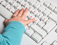Baby hand with keyboard. Early education Royalty Free Stock Images