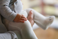 Baby hand and knee. Stock Images