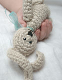 Baby hand with knitted rabbit Royalty Free Stock Photo