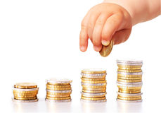 Baby hand and money isolated over white Royalty Free Stock Photos