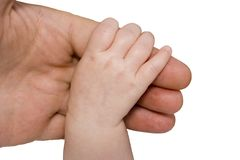Baby hand and parent arm stock photo