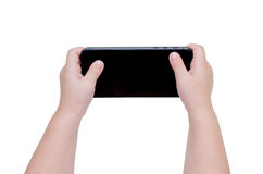 Baby hand playing game on smart phone over white Royalty Free Stock Images