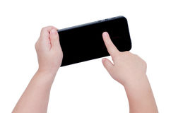 Baby hand pointing smart phone screen on white backgrou Stock Photo