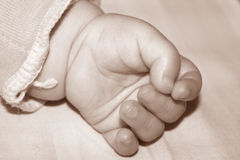 Baby Hand Sepia Stock Images