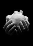 Baby in Hands. Newborn baby head in hands stock photos