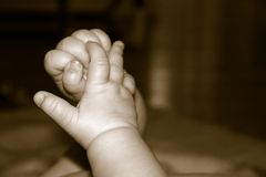 Baby hands. Sepia baby hands stock photography