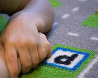 Baby hands on the colorful carpet Stock Photo