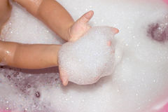 Baby hands with foam Royalty Free Stock Photos