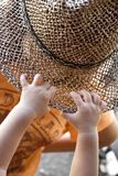 Baby hands grab a hat Stock Images