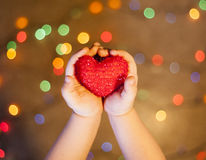 Baby hands holding a heart Royalty Free Stock Images