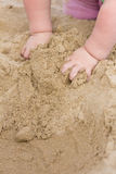 Baby hands in sand Royalty Free Stock Images
