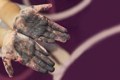 Baby hands smeared with paint. Painted in skin hands. Creative concept.  stock photos
