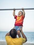 Baby hanging Stock Image
