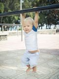 Baby hanging Stock Images