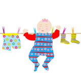 Baby hanging on a string Stock Images