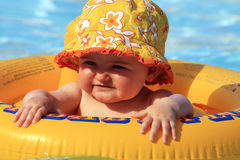 Baby happy. In a very small pool on the beach Stock Photography