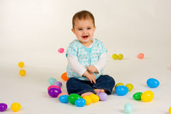 Baby Happy about Easter Eggs 3. Cute baby girl with easter plastic eggs stock photography