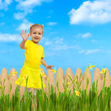 Baby happy flowers garden background waving hello Stock Photography