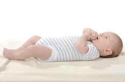 Baby. Happy baby with fresh changed diapers Royalty Free Stock Photo