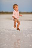 Baby in a happy jump Royalty Free Stock Photography