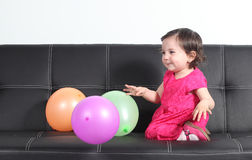Baby happy playing with balloons royalty free stock photo