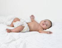 Baby happy to play with himself. Stock Images