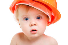 Baby in hardhat. Portrait of a baby in the orange hardhat Royalty Free Stock Photography