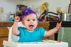 Baby Has a Tantrum. A baby girl throws a tantrum in the kitchen stock photography