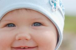 Baby in hat. Portrait of beautiful baby in blue hat Royalty Free Stock Photography