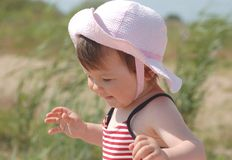 Baby in hat. Portrait of beautiful baby in rose hat on the beach Stock Photo