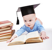Baby in a hat of the bachelor and the book. Royalty Free Stock Photo
