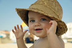 Baby with hat on the beach Royalty Free Stock Images