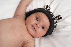 Baby in the hat with ears Stock Images