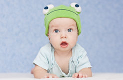 Baby in the hat frog. Lying on his stomach stock photo