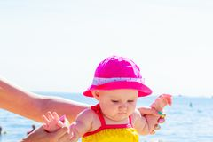 Child holding adult hands on beach royalty free stock photos