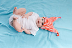 Baby in hat lying Royalty Free Stock Photography