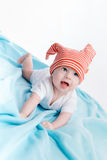 Baby in hat lying Stock Photography