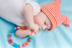 Baby in hat lying Stock Image