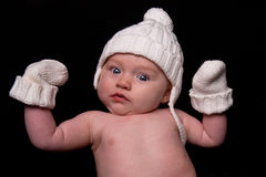 Baby in Hat and Mittens on Black Royalty Free Stock Photos