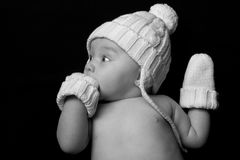 Baby in Hat and Mittens on Black Royalty Free Stock Photo