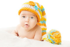 Baby hat newborn portrait in woolen cap over white background Royalty Free Stock Photography