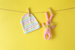 Baby hat at and rope with rabbit toy Royalty Free Stock Photos