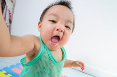 Baby have fun. Stock Image