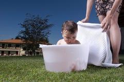 Baby having bath outdoors Royalty Free Stock Photo